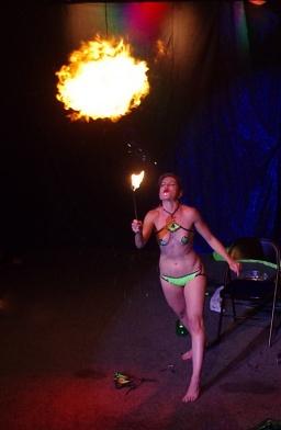 Mercy breathes fire at Burlesque Noir's Danger show in 2015.