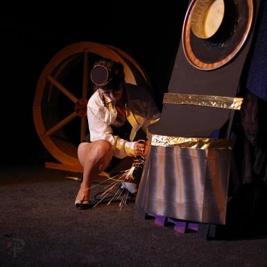 Godiva Bleu fixes her train at Doc Wilson's Medicine Show.
